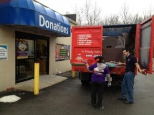 Fire Dawgs donating used furniture at Goodwill