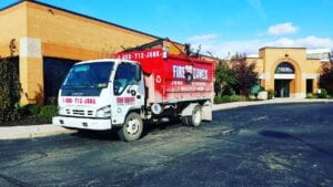 Fire Dawgs truck performing Commercial Junk Removal