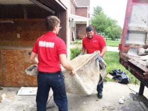 Image of carpet being removed in Indianapolis by Fire Dawgs Junk Removal