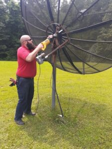a picture of satellite dish removal in indianapolis