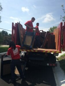 Fire Dawgs Junk Removal cleaning out an attic in Indianapolis