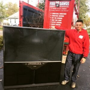 image of television being removed by Fire Dawgs Junk Removal in indianapolis